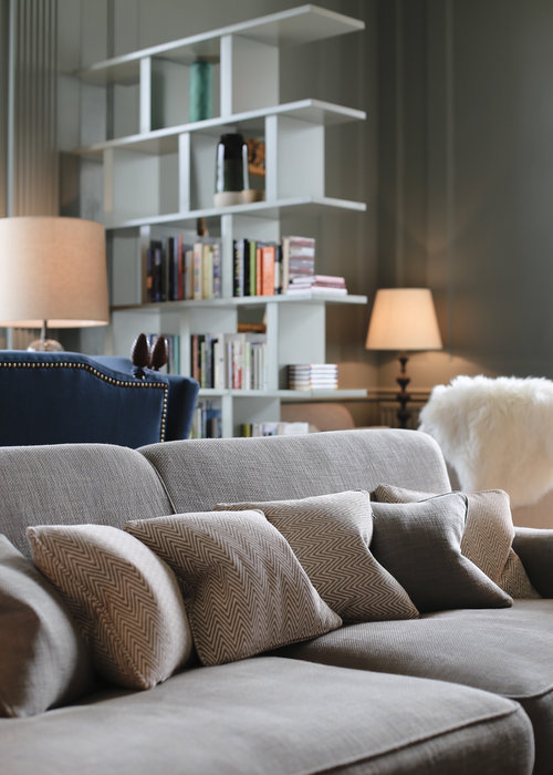 soft furnishings and grey sofa with reading books in the lake district
