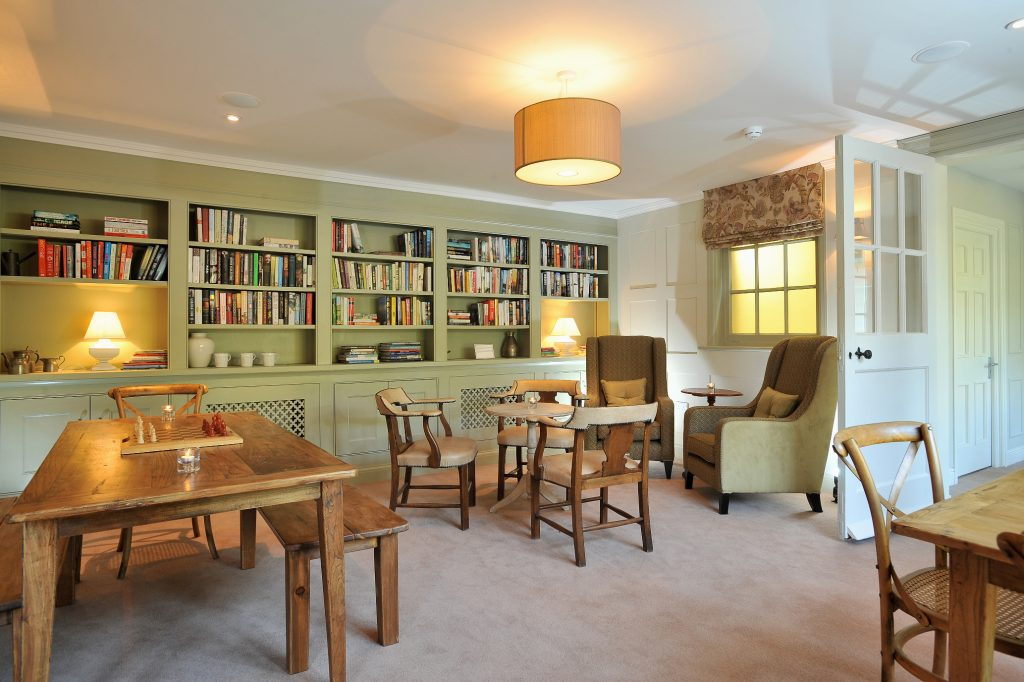 library in norfolk with curated books and cosy seating