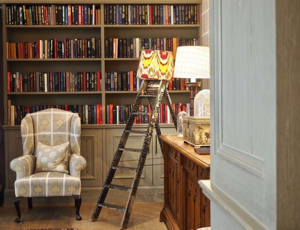 armchair in london hotel with colourful books