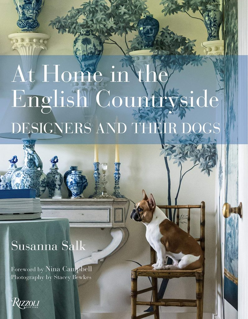Cover of the book At Home in the English Countryside. Cover features patterned china and a dog.