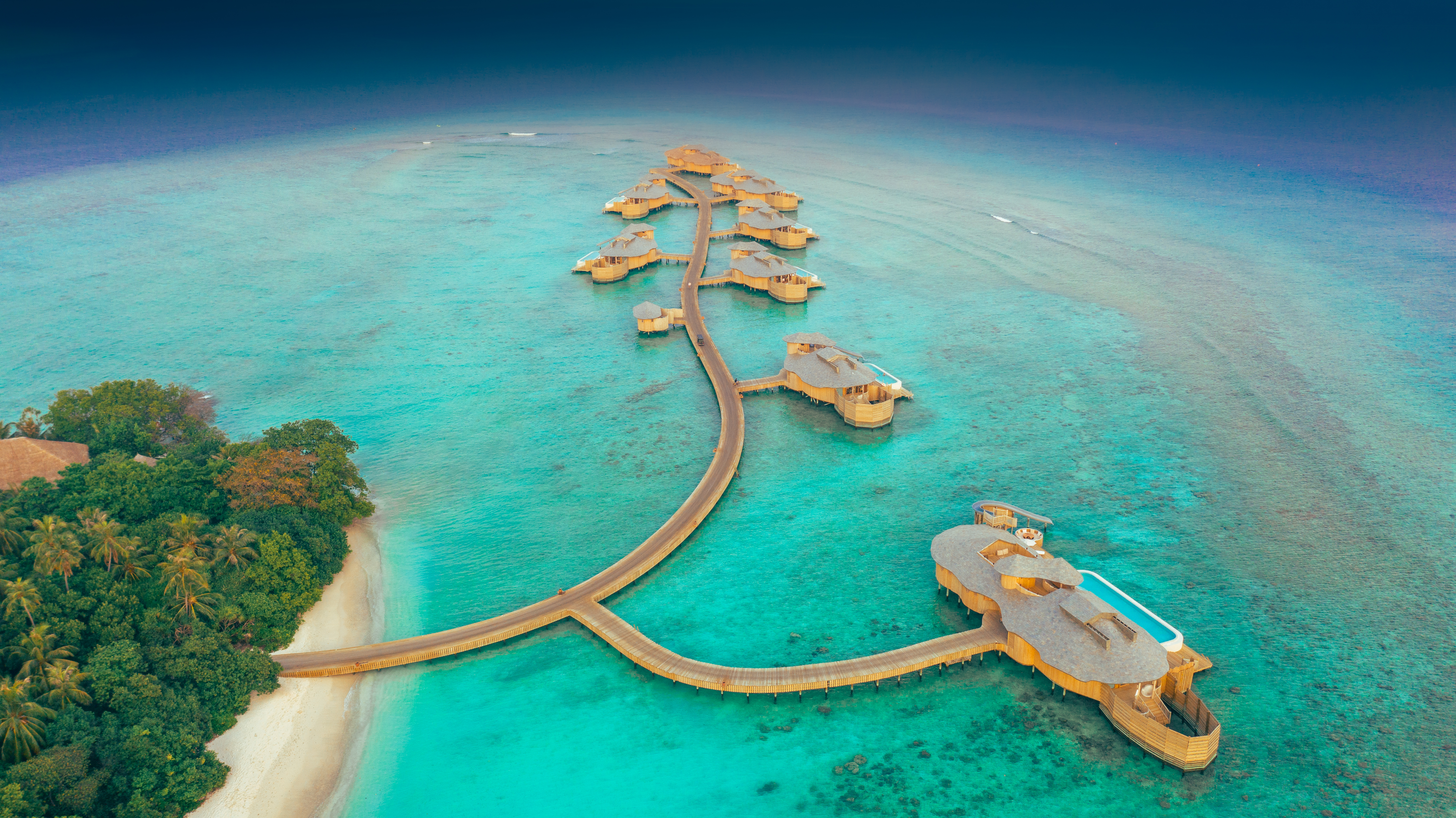 An aerial photograph of the water villas at Soneva Fushi