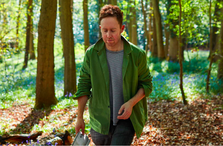 A photograph of interview subject Stuart Ovenden walking through some woodland.
