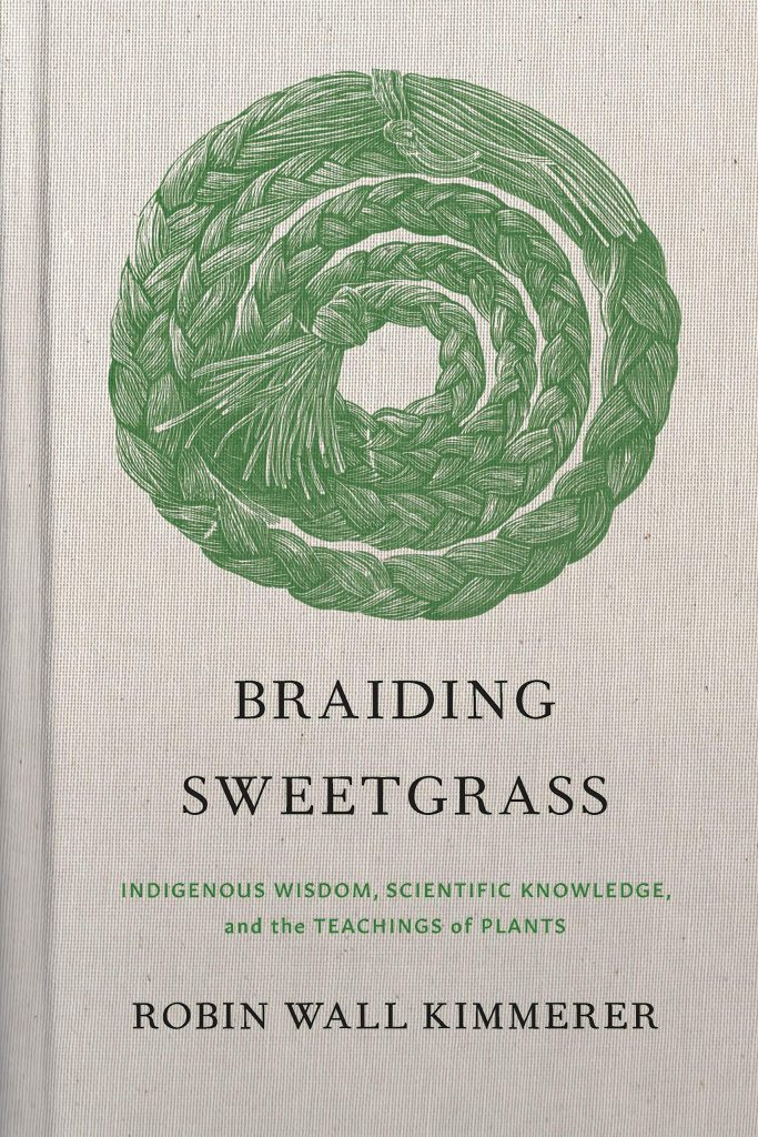 The cover of the book 'Braiding Sweetgrass' by Robin Wall Kimmerer featuring a coil of braised grass and green text on a natural paper background.