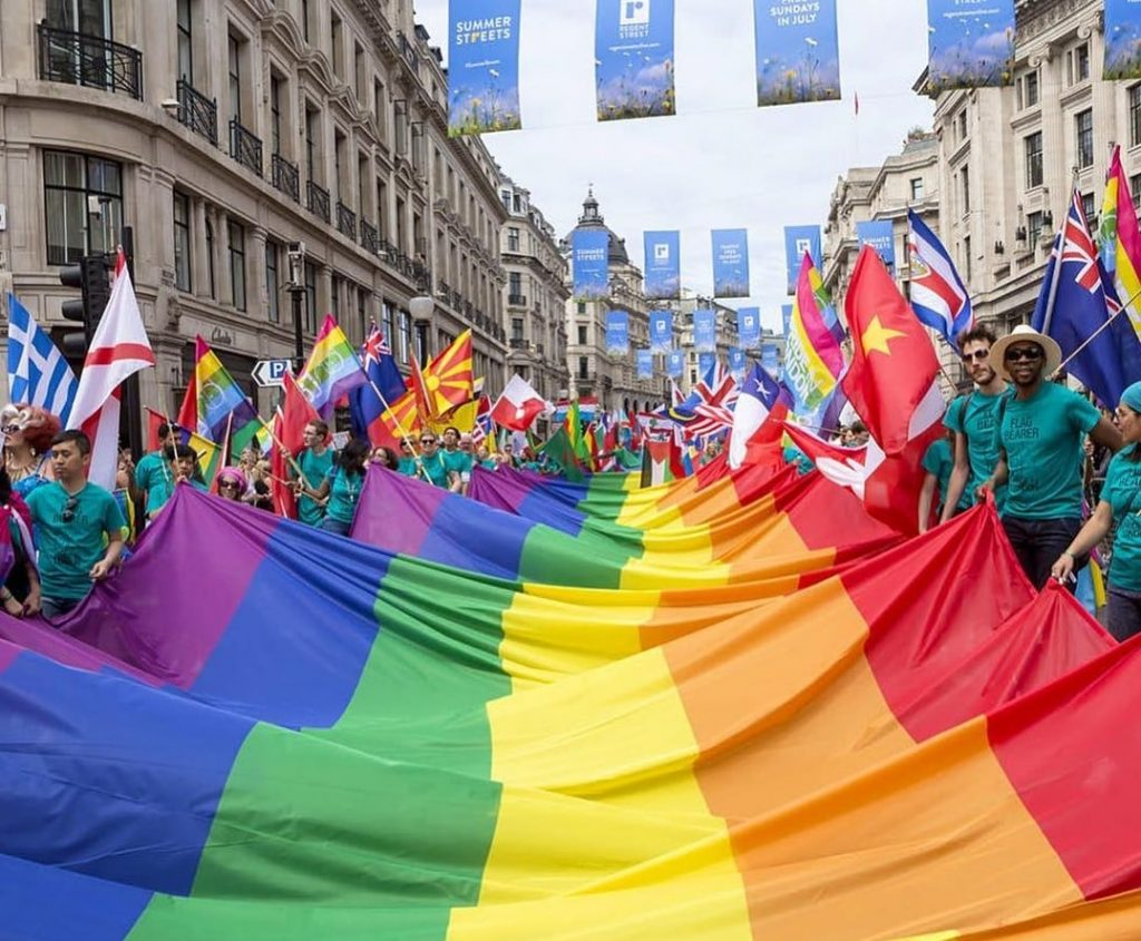 A photograph of a large rainbow flat at the London Pride Parade 2019.
