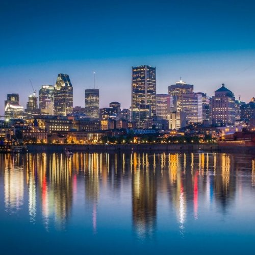 A photograph of Montréal from the water at sunset.