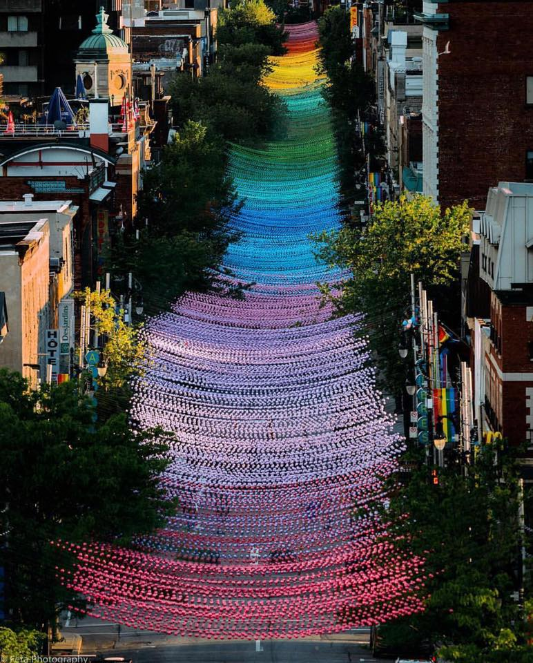 A photograph of the rainbow coloured decorations covering the streets for Montreal's Pride Parade for LGBTQ+ people.