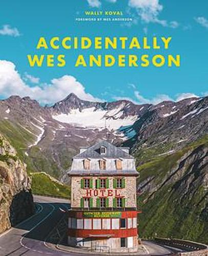 The cover of the book 'Accidentally Wes Anderson' featuring a photograph of a hotel in the middle of a mountain road.
