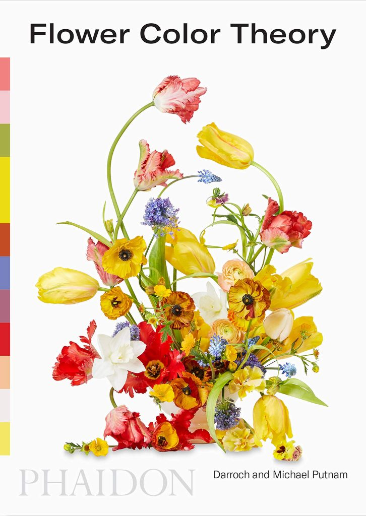 The cover of the book 'Flower Colour Theory' by Darroch and Michael Putnam. It features black text on a white background above an illustration of a floral arrangment.