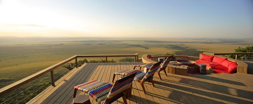 A photograph showing the view from the deck at Angama Mara overlooking the Great Rift Valley in Kenya.