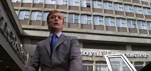 A still from the film 'The Italian Job' showing Michael Caine outside the Royal Lancaster hotel.
