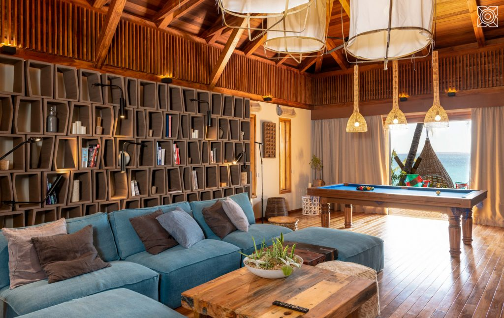 The library at Zuri Zanzibar showing sofas and a pool table.