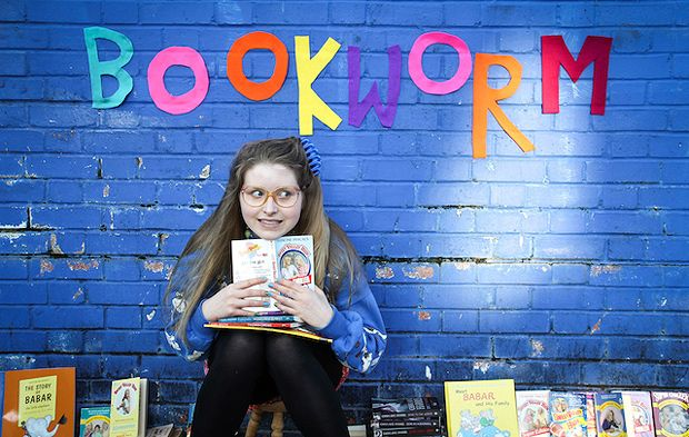 A photograph of Jessie Cave in her peformance 'Bookworm' at the Edinburgh Fringe Festival.