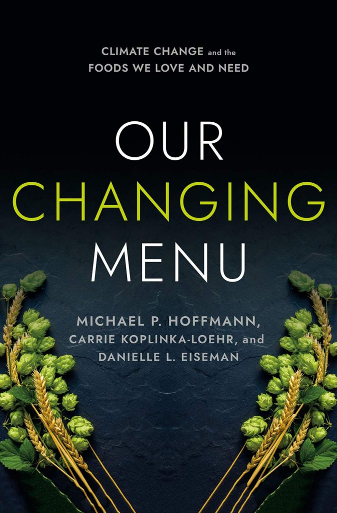 The cover of 'Our Changing Menu' by Michael P. Hoffmann, Carrie Koplinka-Loehr, and Danielle L. Eiseman. It features white and green text on a dark background. At the bottom corners of the page there are grains.